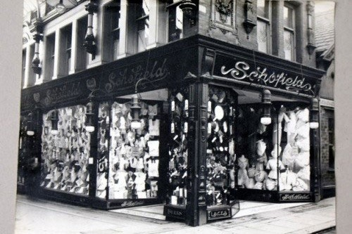 Black and white photo of an old Leeds shop front