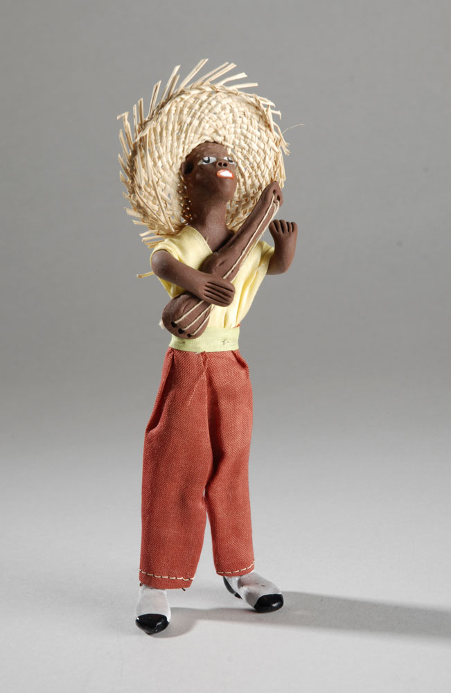 Clay figures of musicians, made in Jamaica, circa 1980.