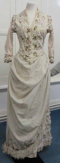 This dress belonged to one of Laura Bonham Carter's (nee Nicholson) daughters also called Laura. Florence was very fond of little Laura and often used to babysit the Bonham-Carter children with her sister Parthenope (Pop). The dress is home made from a Chinese, embroidered silk shawl c. 1880's. Kindly on loan from Rosalind Shallcross, the great great granddaughter of Laura Bonham Carter