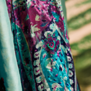 A close up of a blue, purple and turquoise salwar kameez