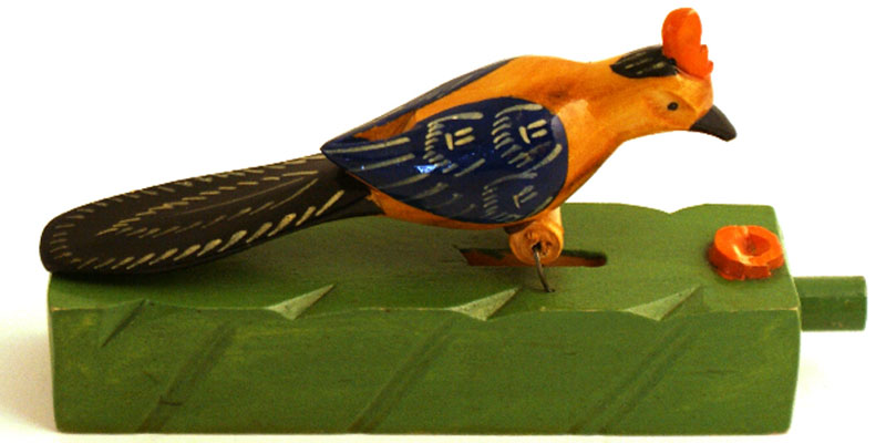 A brightly coloured wooden bird toy