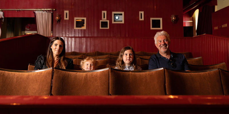 A family are sat in the Palace Picture House of Armley Mills
